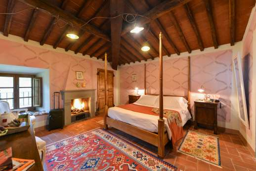 A Cooking Week at I Corbezzoli - Air conditioned double bedroom also with working open fire