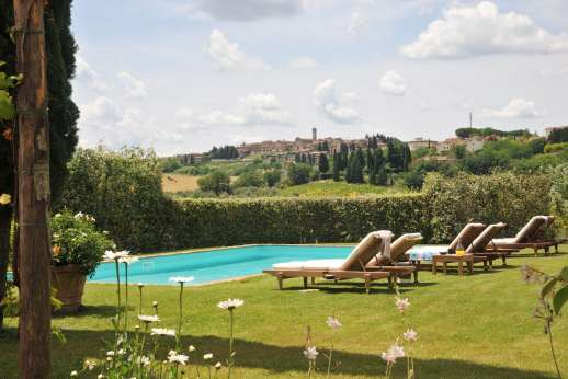 I Tre Cipressi - Lush lawns lead to the private salt water swimming pool, 5.5m x 11.5m/ 18 x 37 feet.