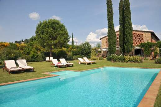 I Tre Cipressi - The pool and villa set in a hectare of olive and fruit trees along with a vegetable garden.