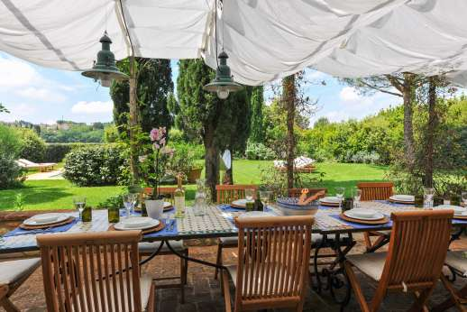 I Tre Cipressi - A paved terrace trails two sides of the villa with a large loggia furnished for alfresco meals.