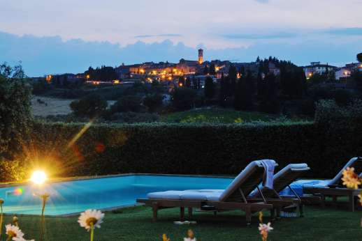 I Tre Cipressi - The fully lit pool perfect for enjoying a refreshing evening swim.