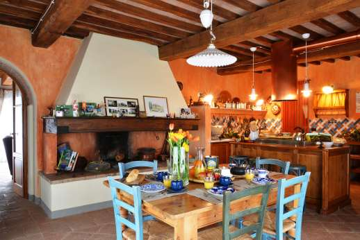 I Tre Cipressi - View of the large kitchen with fireplace.