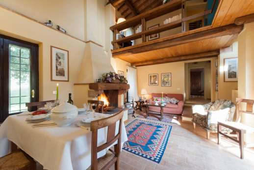 Il Cerro - The sitting, dining room with fireplace.