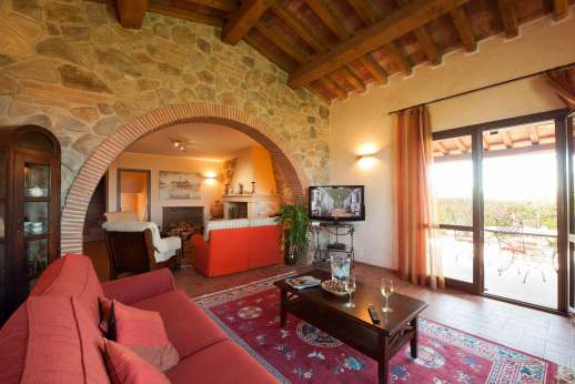 Il Chiesino - Sitting room with a fireplace and French doors leading out to the two loggias
