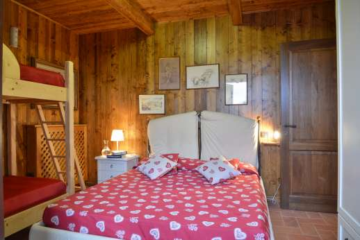 Il Chiesino - Double bedroom with French doors leading out to the garden.