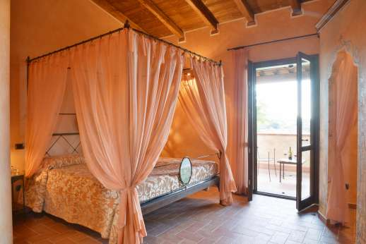 Il Chiesino - The first floor air conditioned double bedroom, with doors out to the terrace.