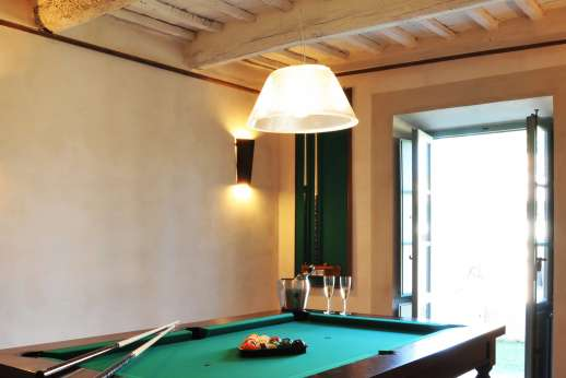 Il Cornello - Billiards room with French doors leading out to the pool area.