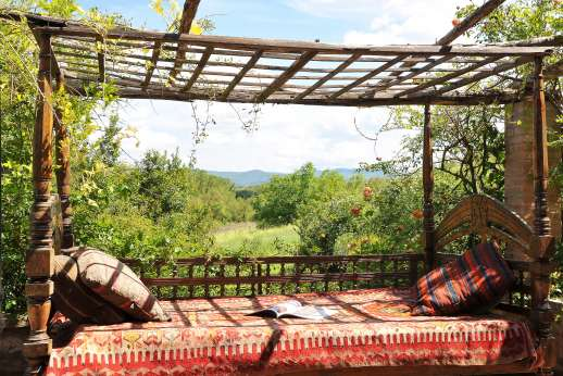 Il Fienile - The terrace with with an Indian bed/settee.