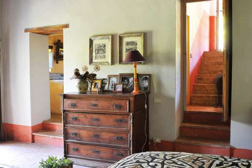 Il Fienile - Opposite view of the lower ground floor bedroom which leads into the garden.