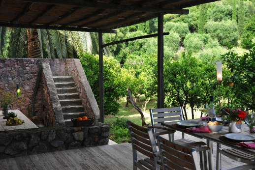 Isola Rossa - View of the dining table under the loggia where you can have delicious al fresco meals.