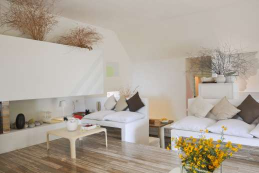 Isola Rossa - Very large air conditioned sitting room on the ground floor, tastefully decorated with stylish and modern furniture.