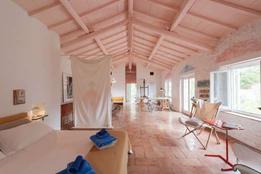 Isola Rossa - High beamed ceiling set the tone for magnificent views out to sea.