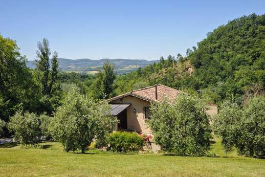 L'Olmo - L'Olmo, the house gazes through a deep valley towards an open countryside of fields and forests.