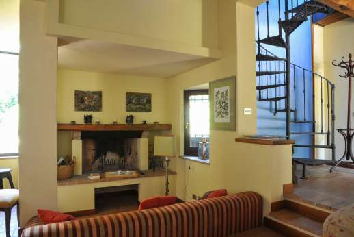 L'Olmo (x 4 people) with Staff and Cook - Sitting room with an open fireplace,