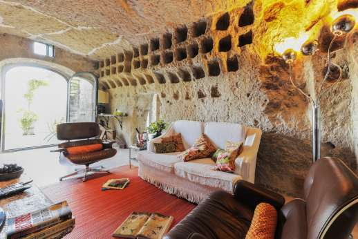 Honeymoon and L'Orto di Alice - The air conditioned sitting room, built into an Etruscan-built grotto.