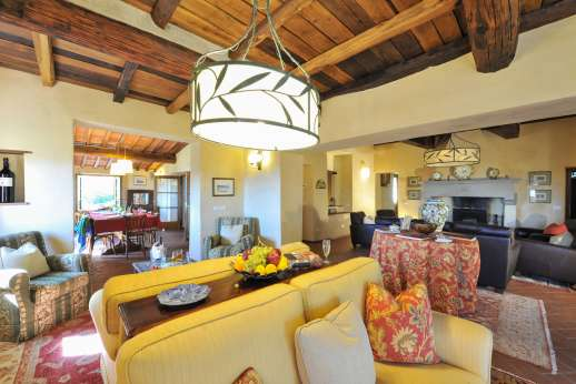 La Casa di Montegrossi - Ground floor, open plan large living room with fireplace.
