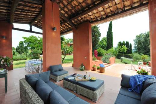 La Casa Rossa - The enormous loggia offers shady sitting and perfect for dining al fresco.