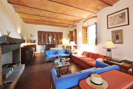 La Casa Rossa - View of the sitting room with open fireplace.