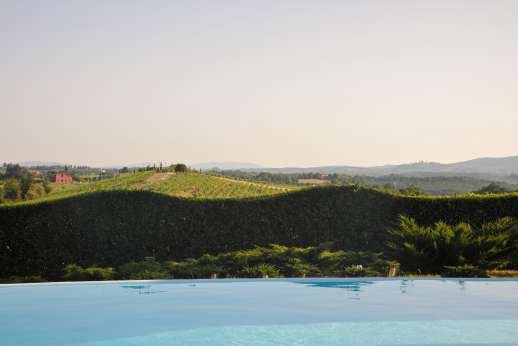 La Casa Rossa - Breathtaking views from the pool terrace of San Gimignano on the distant hill top.