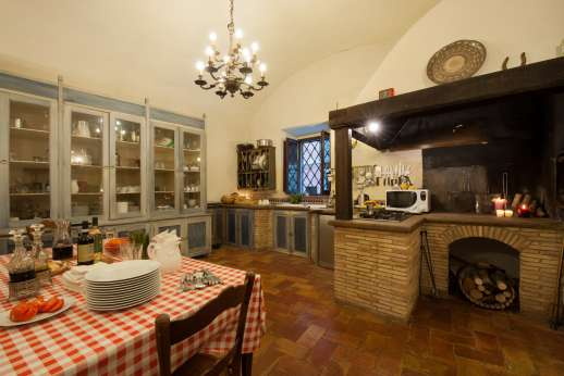 La Fattoria di Sarteano - The old working kitchen with open fireplace