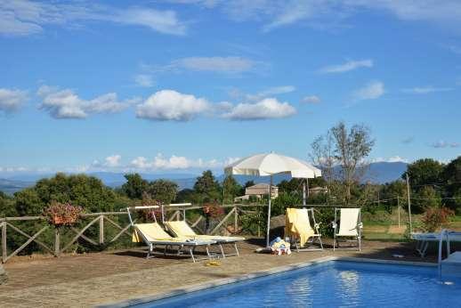 La Grande Quercia - Pool terrace with beautiful views of rolling farmlands.