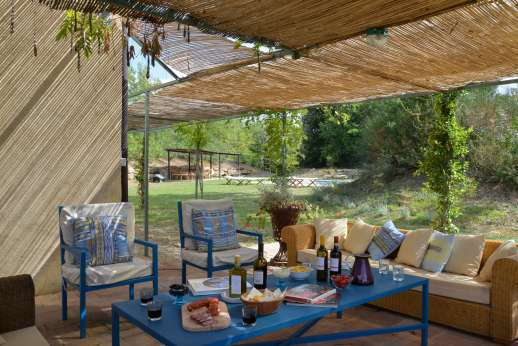 La Magione - Two large terraces lie immediately outside the house: one provides a shaded dining area.