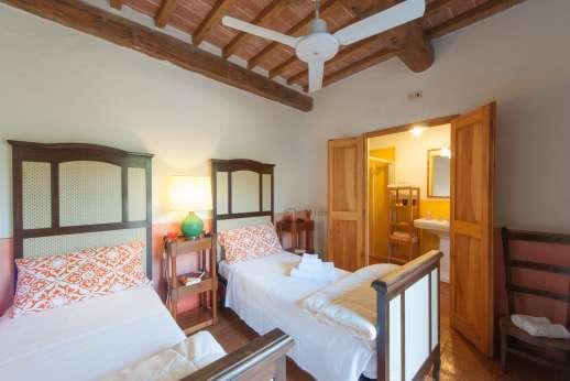 La Magione - Twin bedroom, all bedrooms have private or en suite bathrooms.