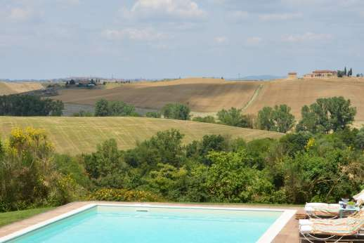 La Piana - The view from the pool with Siena in the distance.