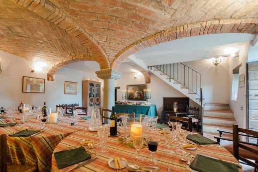 """La Tegolaia - Dine in The """"Taverna"""" set on the lower ground floor with wonderful vaulted ceilings with three large dining tables."""