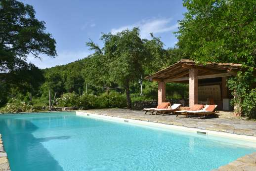 Pergoletto - The pool is set across a level lawn from the house, with a large loggia for shade.