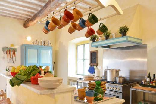 Podere Castelluccio - A kitchen with marble counters and professional stove