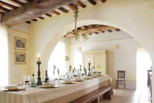 Podere Castelluccio - Elegant dining room with long table.
