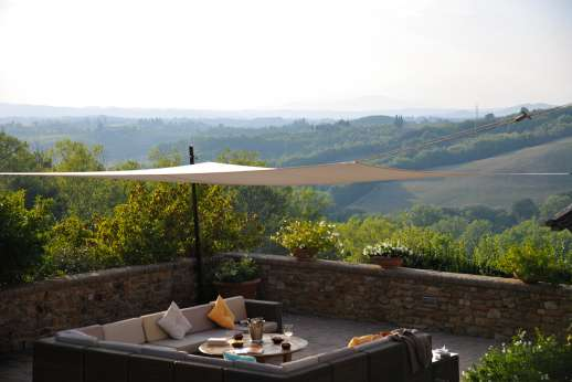 Podere Celli - Relax under the shaded seating area taking in the view
