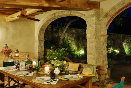 Podere Guicciardini - The large loggia in the court yard is full lit for enjoying your evening meals.