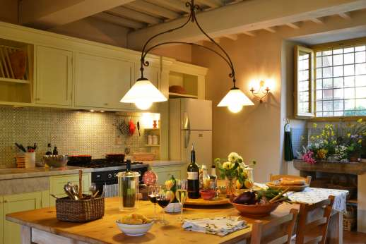 Podere Guicciardini - The well equipped kitchen leads to the loggia and courtyard.