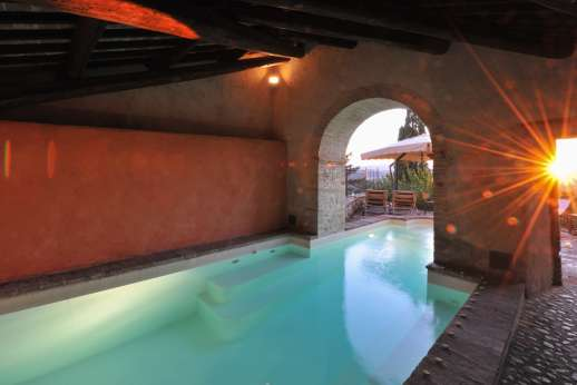 Santi Terzi - The heated swimming pool, 3 x 10m/10 x 32 feet, is set on a stone terrace that is partially sheltered by a colonnade.