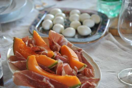 Santi Terzi (x 14 people) with Staff and Cook - Classic dish of melon and prosciutto.