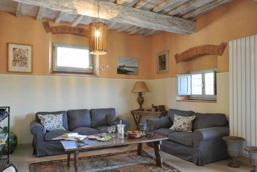 The Estate Of Petroio - Il Borgo di Petroio. large sitting area leading out to wood oven and barbecue area.