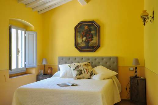 The Estate Of Petroio - Il Borgo di Petroio. Air- conditioned double bedrooms with an en suite bathroom.