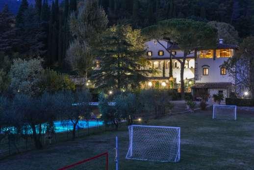 Weddings and The Estate of Petroio - La Villa Di Petroio lit up in the evening