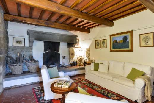The Estate of Petroio with Staff and Cook - Large sitting room with fireplace.