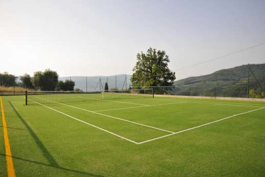 Staffed weddings at The Estate of Petroio - The Estate's astro-turf tennis court.