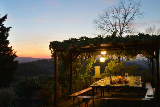 Tizzano - A perfect outdoor dining area, whether daytime or evening.