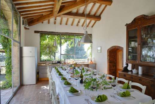 Tizzano - Well-illuminated dining room with table seating 18 and access to courtyard.