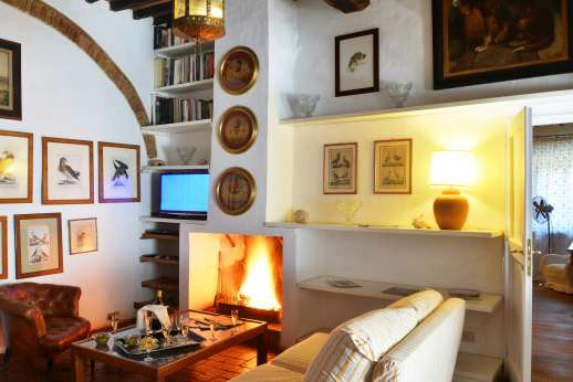 Tizzano - First floor, TV room with fireplace.