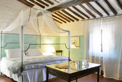 Tizzano - Ground floor independent suite double bedroom with elegant furnishings.