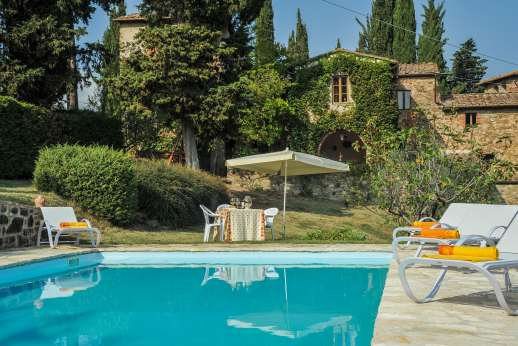 Val di Castello - The pool terrace furnished with sun loungers and umbrella.