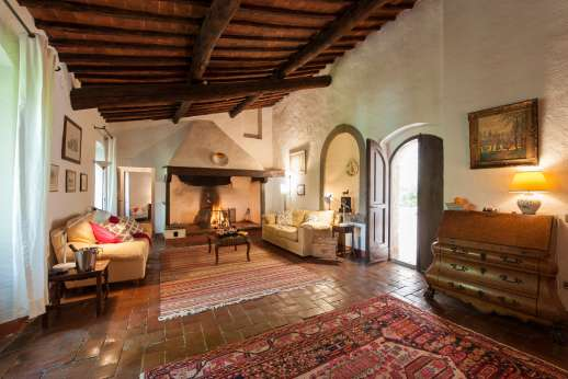 Val di Castello - Sitting room with large working fireplace.
