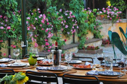 Vecchia Fattoria - The courtyard furnished for dining al fresco.