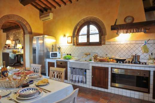 Villa Altea (x 8 people) with Staff and Cook - Fully air conditioned kitchen leading through to the sitting room.